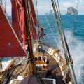 Vega thunders along at over 9 knots in 30 knots of wind with just basic working sails set